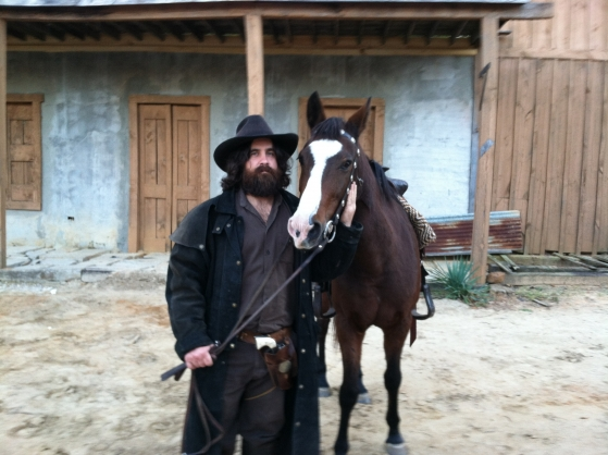 Lesson horse Jester stars in The Merchant. Jester and actor Jaysen Dry on the movie set.